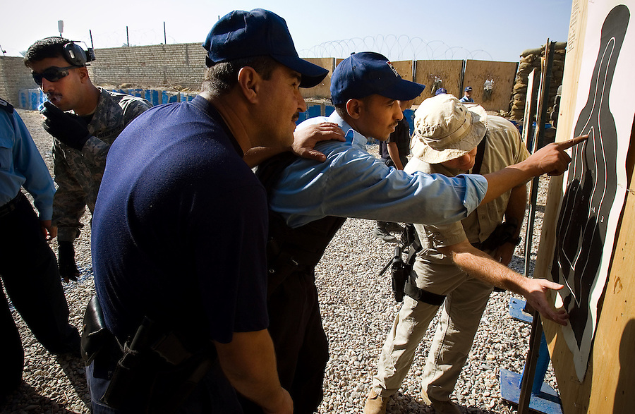 Iraqi Police - under the tutelage of US and Iraqi trainers - undergo weapons training at a facility in the Diyala provincial capital, Baqubah, on Mon. Dec. 4, 2006.<br />