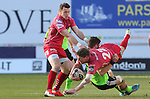 Munster replacement Jack O'Donoghue tackles Scarlets replacement Rhys Priestland.<br /> Guiness Pro12<br /> Scarlets v Munster<br /> 21.02.15<br /> &copy;Steve Pope -SPORTINGWALES