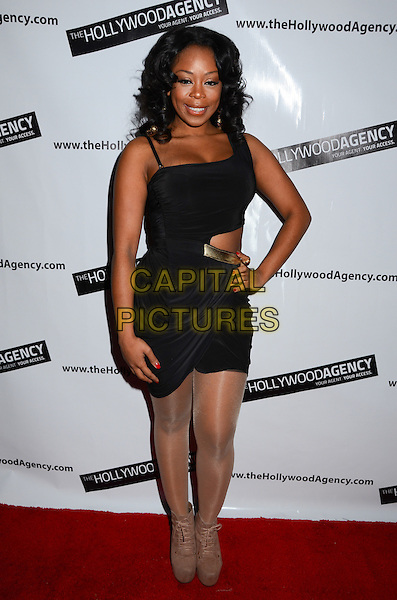 "Shay ""Buckeey"" Johnson.The Hollywood Agency presents a private after party for People's Choice Awards 2012 hosted by Mario Lopez of NBC's ""Extra"" held at Conga Room L.A. Live, Los Angeles, California, USA..January 11th, 2012.full length black dress hand on hip cut out away .CAP/ADM/BT.©Birdie Thompson/AdMedia/Capital Pictures."