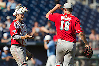 North Carolina State catcher Brett Austin (11) congratulates pitcher Carlos Rodon (16 after he threw a complete game in Game 3 of the 2013 Men's College World Series between the North Carolina State Wolfpack and North Carolina Tar Heels at TD Ameritrade Park on June 16, 2013 in Omaha, Nebraska. The Wolfpack defeated the Tar Heels 8-1. (Andrew Woolley/Four Seam Images)