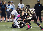Torrance, CA 10/02/15 - Kyrin Cannon (Carson #1), Davione Germany (West #32), Shea Wissler (West #5) and Ryan Shoda (West #55)  in action during the Carson-West Torrance CIF varsity football game at West Torrance High School.  Carson defeated West Torrance 34-27.