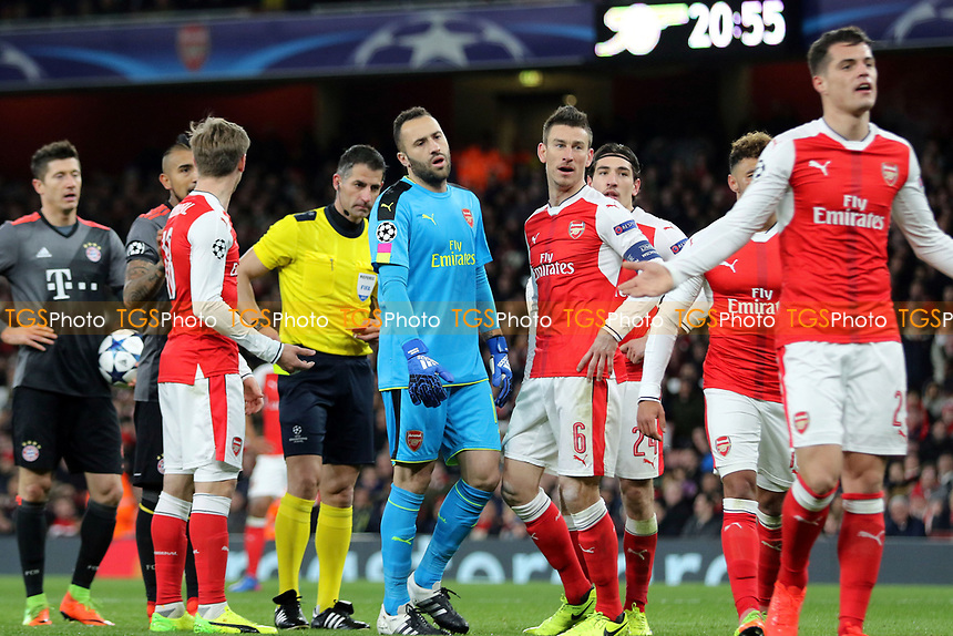Arsenal's Laurent Koscielny's reaction after being shown a red card during Arsenal vs FC Bayern Munich, UEFA Champions League Football at the Emirates Stadium on 7th March 2017