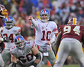 Landover, MD - November 30, 2008 -- New York Giants quartetback Eli Manning (10) directs the offense in fourth quarter action against the Washington Redskins at FedEx Field in Landover, Maryland on Sunday, November 30, 2008..Credit: Ron Sachs / CNP.(RESTRICTION: No New York Metro or other Newspapers within a 75 mile radius of New York City)