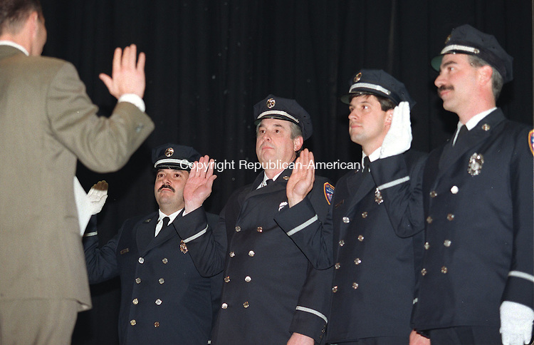WATERBURY,CT. 12/18/98--1218SV05.tif--During a ceremony at Kennedy High in Waterbury Michael Couture, Michael Farrell, Peter Cherubini, and Felix Sambuco were promoted to Captain in The Waterbury Fire Department on Friday. Steven Valenti Photo