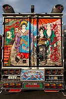 "Are they long-haul discos, works or art on wheels, personal statements of truck drivers? Dekotora is an abbreviation for decorated truck.  These gaudy, tricked-up trucks are usually found in rural areas of Japan where wheels are important.  Though artistically decorated trucks and buses can be found outside Japan, what sets the Japanese version apart is the level of expertise, artistry and intricate finishes on the lighting apparatus and paint jobs.  They are usually best viewed when illuminated thanks to their neon, ultraviolet, strobe and flashing lights.  Occasionally they are even fitted with fancy interiors with chandeliers and other paraphernalia to give them an added kick.  These unique trucks first came onto the scene in the 1970s, and appeared in the public consciousness with the Japanese movie ""Trucker Guys"".  Some decotora follow historical themes while others show more interest in animals or are all about lights.  Tigers and dragons are favorites.  Even some video games have taken on the theme of dekotora with trucks as heroes or villains."