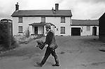 Upper Basildon, Berkshire. 1983<br /> A farm labourer on his way home, walks past his local pub, The Fox and Cubs that had recently closed down.