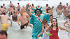 Dave McDermott of Long Branch and dressed as Lady Liberty exits the water at the Polar Plunge in Seaside Heights to benefit Special Olympics.