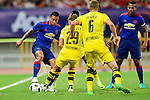 Manchester United winger Memphis Depay (l) fights for the ball with Borussia Dortmund defender Marcel Schmelzer (r) during the International Champions Cup China 2016, match between Manchester United vs Borussia  Dortmund on 22 July 2016 held at the Shanghai Stadium in Shanghai, China. Photo by Marcio Machado / Power Sport Images