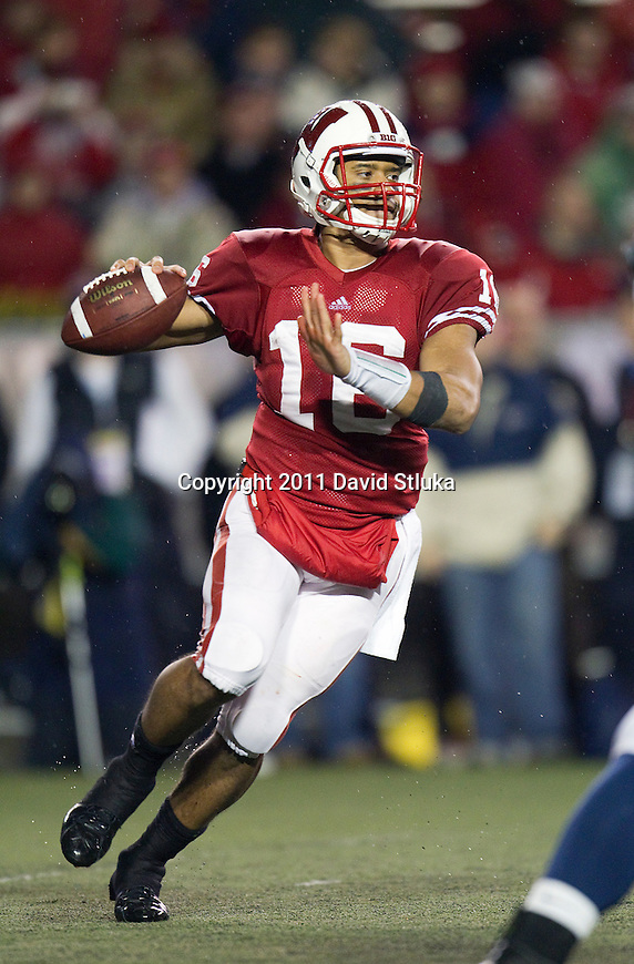 Wisconsin Badgers quarterback Russell Wilson (16) throws a pass during an NCAA Big Ten Conference college football game against the Penn State Nittany Lions on November 26, 2011 in Madison, Wisconsin. The Badgers won 45-7. (Photo by David Stluka)