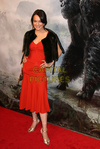 "LINDSAY LOHAN.Universal Pictures' ""King Kong"" New York City Premiere - Arrivals at Loews E-Walk & AMC Empire Cinemas, New York City..December 5th, 2005 .Ref: IW.full length red dress black fur shawl hands on hips.www.capitalpictures.com.sales@capitalpictures.com.©Capital Pictures"