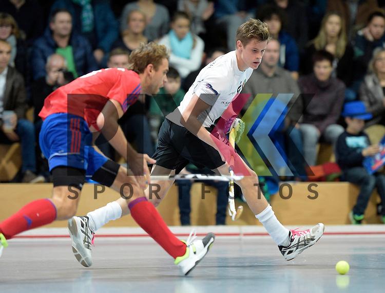 GER - Mannheim, Germany, November 28: During the 1. Bundesliga Sued Herren indoor hockey match between Mannheimer HC (red) and TG Frankenthal (white) on November 28, 2015 at Irma-Roechling-Halle in Mannheim, Germany. Final score 7-7 (HT 3-3).  Johannes Gans #6 of TG Frankenthal, Florian Woesch #25 of Mannheimer HC<br /> <br /> Foto &copy; PIX-Sportfotos *** Foto ist honorarpflichtig! *** Auf Anfrage in hoeherer Qualitaet/Aufloesung. Belegexemplar erbeten. Veroeffentlichung ausschliesslich fuer journalistisch-publizistische Zwecke. For editorial use only.