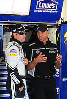 Oct 3, 2008; Talladega, AL, USA; NASCAR Sprint Cup Series driver Jimmie Johnson (left) talks with crew chief Chad Knaus during practice for the Amp Energy 500 at the Talladega Superspeedway. Mandatory Credit: Mark J. Rebilas-