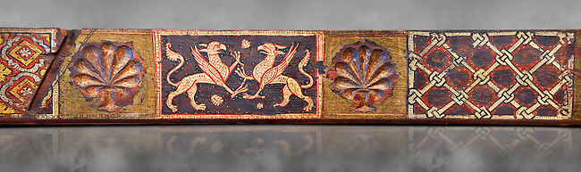 Gothic decorative painted beam panels with griffins and a carved syalise tree, Tempera on wood. National Museum of Catalan Art (MNAC), Barcelona, Spain. Against a grey art background.
