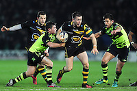 JJ Hanrahan of Northampton Saints takes on the Leinster defence. European Rugby Champions Cup match, between Northampton Saints and Leinster Rugby on December 9, 2016 at Franklin's Gardens in Northampton, England. Photo by: Patrick Khachfe / JMP