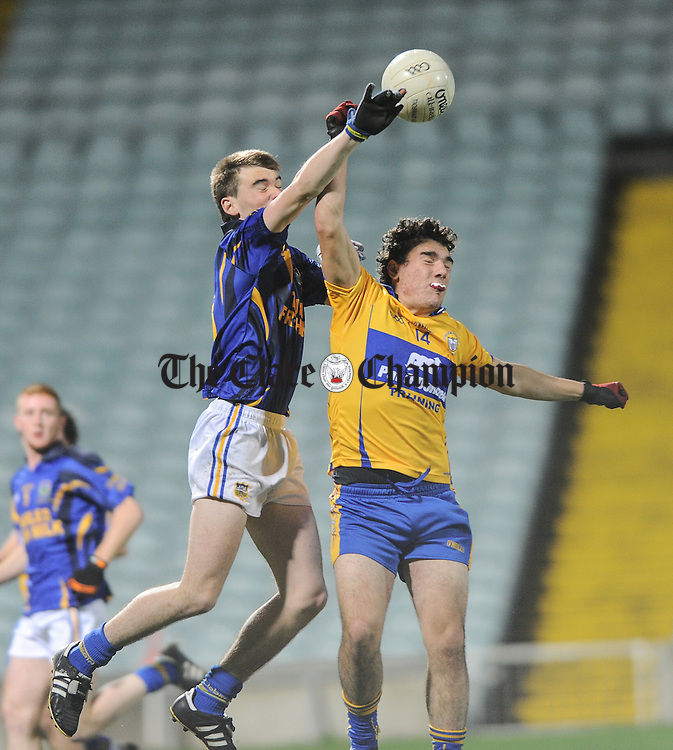 Jack Skeehan of Tipperary in action against Alan Sweeney of Clare during their U-17 Munster League final in The Gaelic Grounds. Photograph by John Kelly.