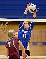 NWA Democrat-Gazette/BEN GOFF @NWABENGOFF<br /> Hannah Martin (11) of Rogers jumps to block a ball hit by Shaylon Sharp (7) of Siloam Springs jumps to block on Thursday Aug. 27, 2015 during the match at Rogers High.