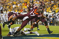 Landover, MD - September 3, 2017: Virginia Tech Hokies quarterback Josh Jackson (17) scores a touchdown during game between Virginia Tech and WVA at  FedEx Field in Landover, MD.  (Photo by Elliott Brown/Media Images International)