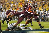 Landover, MD - September 3, 2017: Virginia Tech Hokies quarterback Josh Jackson (17) scores a touchdown during game between Virginia Tech and WVA at  FedEx Field in Landover, MD.  (Photo by Elliott Brown/Media Images International)