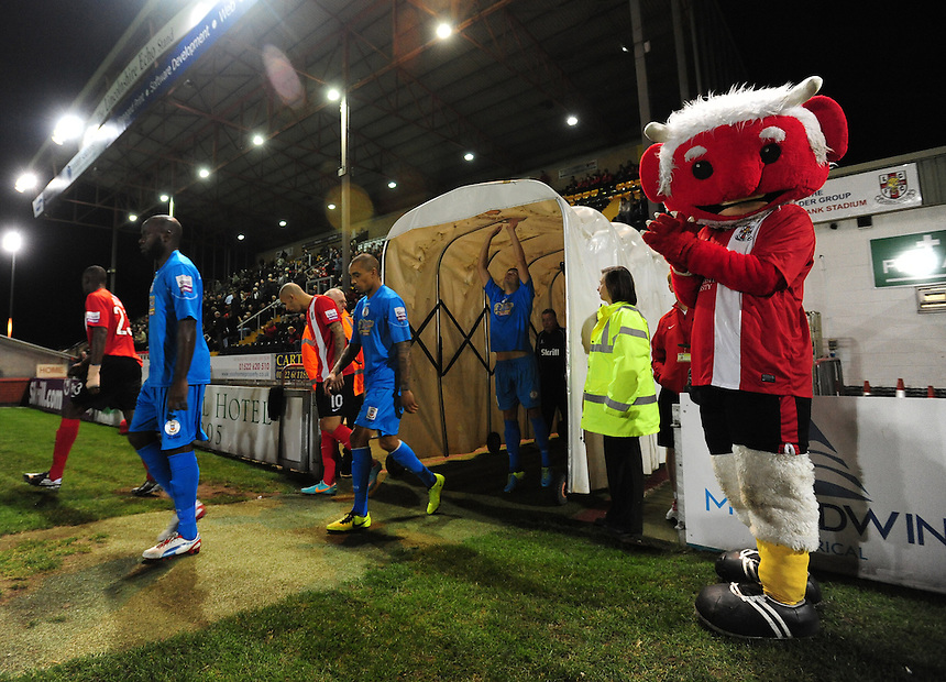 Lincoln City mascot Poacher the Imp, right, welcomes the Lincoln City and Tamworth players out onto the pitch ahead of kick off<br /> <br /> (Photo by Chris Vaughan/CameraSport)<br /> <br /> Football - The Skrill Premier - Lincoln City v Tamworth - Tuesady 8th October 2013 - Gelder Group Sincil Bank Stadium - Lincoln<br /> <br /> &copy; CameraSport - 43 Linden Ave. Countesthorpe. Leicester. England. LE8 5PG - Tel: +44 (0) 116 277 4147 - admin@camerasport.com - www.camerasport.com