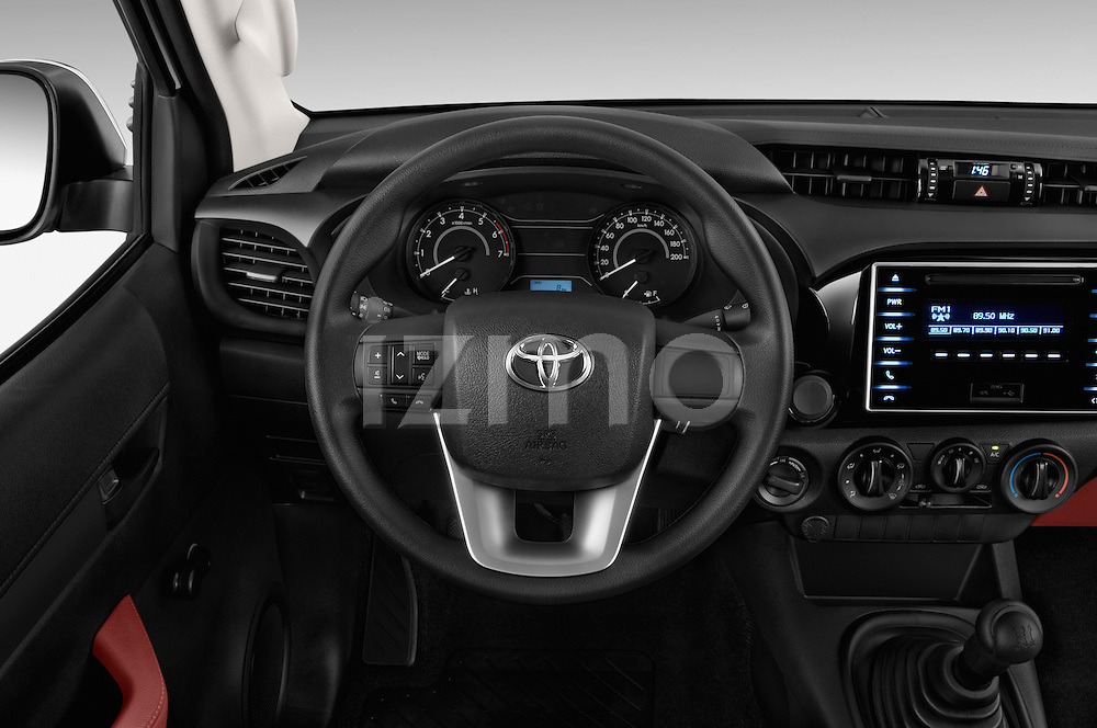 Car pictures of steering wheel view of a 2016 Toyota Hilux GL 4 Door Pickup Steering Wheel