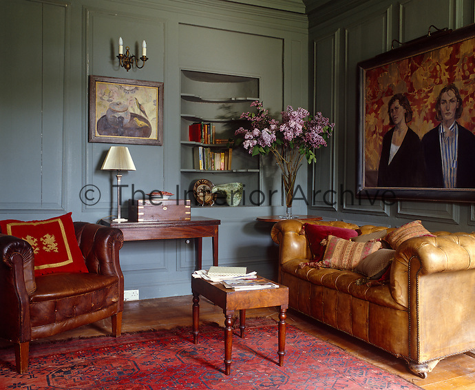 A double portrait of the Dilworth sisters by Binny Matthews is a focal point in this panelled living room