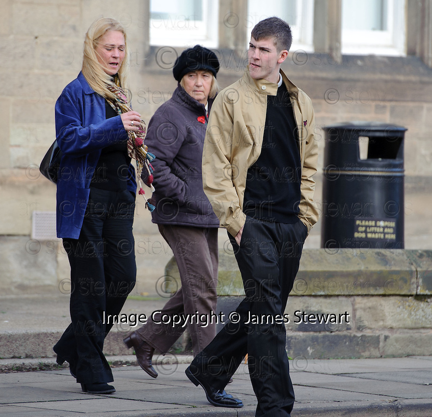 Lewis Goram, son of former Rangers and Scotland goalkeeper Andy Goram, leaves Duns Sheriff Court after being fined £200 for racial abuse  .... He his seen with his mother, and Goram's ex wife, Tracy ...