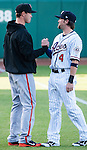 Former Ace Cole Gillespie now playing for the Fresno Grizzlies shakes hands with Aces Taylor Harbin before their game on Friday night, April 26, 2013 in Reno, Nevada.