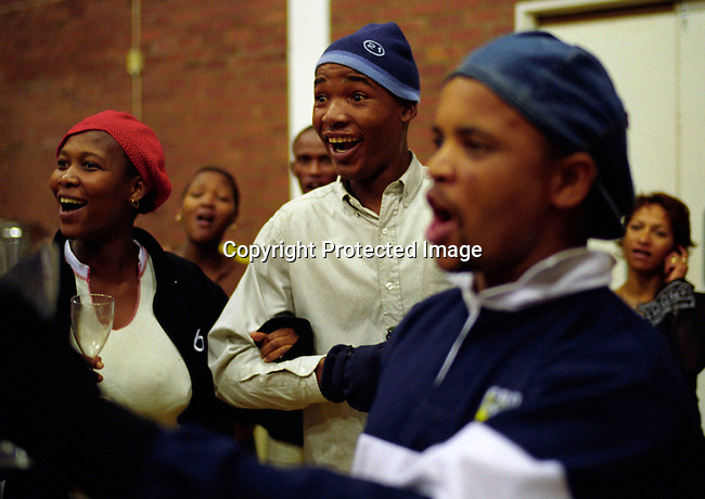 DIDANCE00149.Theatre. People Arts, group, culture, opera, singing, black, Young black people rehearsing for an opera performance in a Guguletu, South Africa. They trained for La Traviata. .©Per-Anders Pettersson/iAfrika Photos..