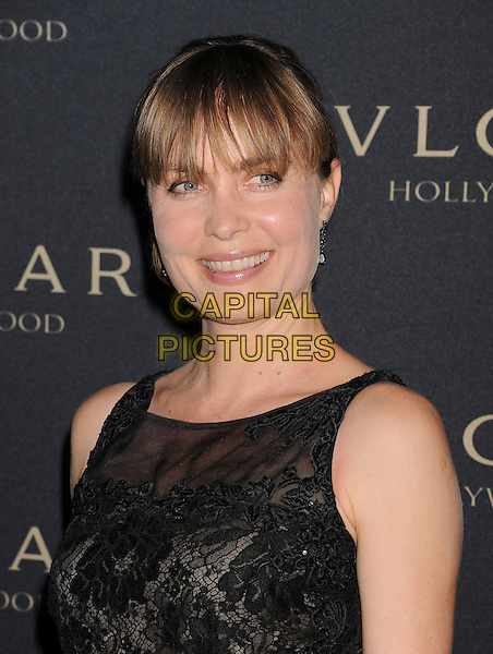 WEST HOLLYWOOD, CA- FEBRUARY 25: Actress Radha Mitchell arrives at the BVLGARI 'Decades Of Glamour' Oscar Party Hosted By Naomi Watts at Soho House on February 25, 2014 in West Hollywood, California.<br /> CAP/ROT/TM<br /> &copy;Tony Michaels/Roth Stock/Capital Pictures