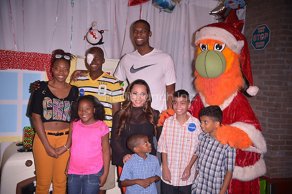 MIAMI, FL - DECEMBER 17: Chris Bosh and wife Adrienne Bosh poses for picture during the Christmas With Chris Bosh At 'Santa Bosh's Workshop at Game Time at Sunset Place on December 17, 2012 in Miami, Florida. © MPI10/MediaPunch Inc
