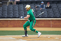 Niko Kavadas (12) of the Notre Dame Fighting Irish follows through on his swing against the Wake Forest Demon Deacons at David F. Couch Ballpark on March 10, 2019 in  Winston-Salem, North Carolina. The Demon Deacons defeated the Fighting Irish 7-4 in game one of a double-header.  (Brian Westerholt/Four Seam Images)
