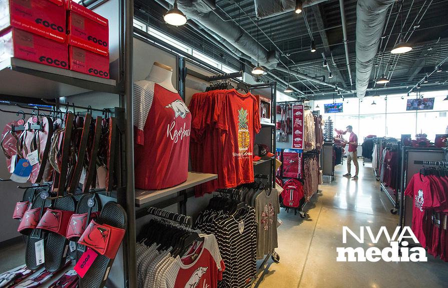 NWA Democrat-Gazette/BEN GOFF @NWABENGOFF             Merchandise hangs on display Wednesday, Aug. 7, 2019, at the new Hog Heaven shop on the North side of Reynolds Razorback Stadium in Fayetteville.