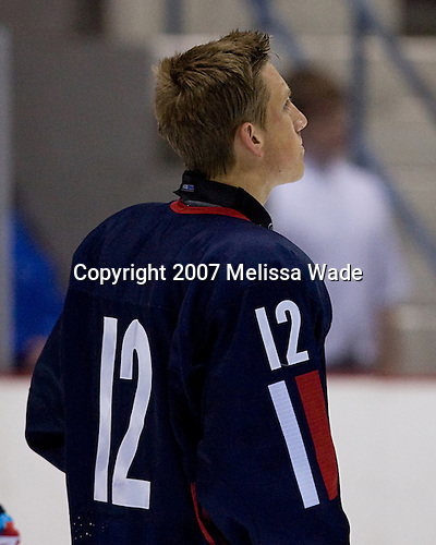Jordan Schroeder (US/US Under-18 - Lakeville, MN) lines up for the anthem before the game. USA Hockey puts on a national junior evaluation camp each August to help determine members of the US Under-20 team for the World Juniors tournament and invites enough players to make up two teams, Team White and Team Blue.  The two teams scrimmage twice prior to playing Finland and Sweden and in their second meeting on Monday, August 6, 2007, Team White defeated Team Blue 4-3 at the 1980 Rink in Lake Placid, New York.