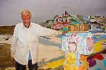 Leonard Knight artist and creator of Salvation Mountain with with art mailbox out by the Slabs near Niland, Calif...Leonard Knight is a gentle and friendly man who is sharing his passion for God with all comers in the Imperial Valley.