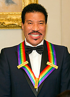 Lionel Richie, one of he five recipients of the 40th Annual Kennedy Center Honors with his award as he poses for a group photo following a dinner hosted by United States Secretary of State Rex Tillerson in their honor at the US Department of State in Washington, D.C. on Saturday, December 2, 2017. The 2017 honorees are: American dancer and choreographer Carmen de Lavallade; Cuban American singer-songwriter and actress Gloria Estefan; American hip hop artist and entertainment icon LL COOL J; American television writer and producer Norman Lear; and American musician and record producer Lionel Richie. Photo Credit: Ron Sachs/CNP/AdMedia