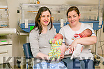 LEAP YEAR BABY: Kathleen Walsh Lawlor, Newmarket, with her baby Lorcan and midwife Pam Doyle with baby Colm Og O'Sullivan, Muckross who were born on February 29th.