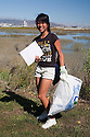 "Shorhon Gong from Aragon High School cleaning up at Bayfront Park. Volunteers in the City of Millbrae participated in California Coastal Cleanup Day on 9/19/09. Participants cleaned up inland locations throughout the city as well as at Bayfront Park on the San Francisco Bay shoreline. The inland cleanup efforts were important because, according to the California Coastal Commission, ""past Coastal Cleanup Day data tell us that most (between 60-80 percent) of the debris on our beaches and shorelines comes from inland sources, traveling through storm drains or creeks out to the beaches and ocean. Rain or even something as simple as hosing down a sidewalk can wash cigarette butts, bits of styrofoam, pesticides, and oil into the storm drains and out to the ocean."" The California Coastal Cleanup Day (http://www.coastal.ca.gov/publiced/ccd/ccd.html) is sponsored by the California Coastal Commission and is a part of the International Coastal Cleanup organized by The Ocean Conservancy."