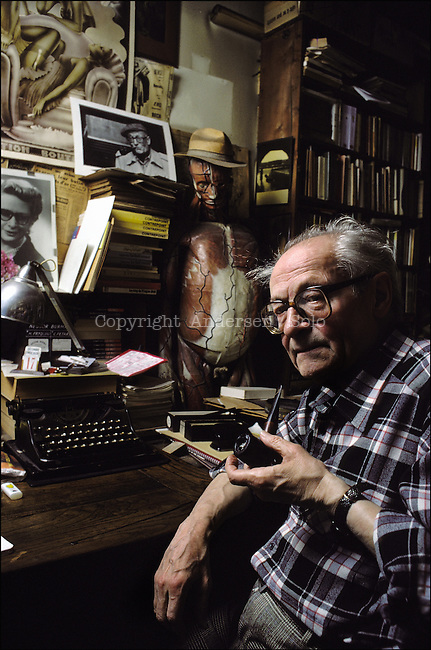 Leo Malet at home in his office in Montrouge in Paris suburb, in 1986.
