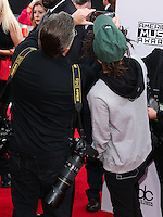 LOS ANGELES, CA, USA - NOVEMBER 23: Kevin Mazur, Jaden Smith arrive at the 2014 American Music Awards held at Nokia Theatre L.A. Live on November 23, 2014 in Los Angeles, California, United States. (Photo by Xavier Collin/Celebrity Monitor)