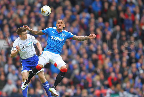 10.04.2016. Hampden Park, Glasgow, Scotland. Petrofac Training Cup Final. Rangers versus Peterhead. James Tavernier jumps with Jamie Redman for the ball