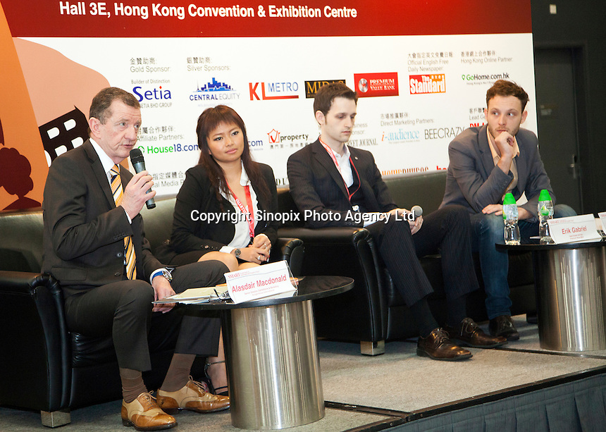 Alisdair Macdonald of Knight Knox International Ltd, speaking at a seminar at the Smart International Property Investment Expo at the Hong Kong Convention and Exhibition Centre in Hong Kong. <br /> 07-08 June, 2014<br /> <br /> Photo by Tim O'Rourke / Sinopix