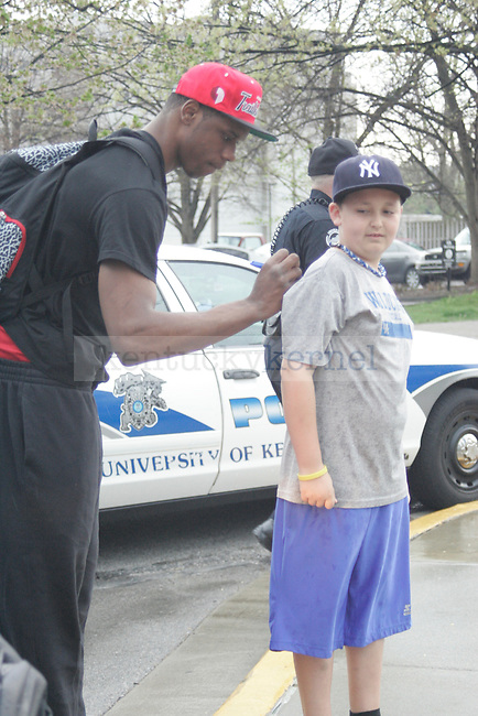 UK forward Terrence Jones signs an autograph for a fan before he  gets on the bus to leave for New Orleans for the Final Four game in Lexington, Ky. on March 28, 2012. Photo by Quianna Lige | Staff