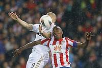 11.04.2012 MADRID, SPAIN - La Liga match played between At. Madrid vs Real Madrid (1-4) with hat-trick of Cristiano Ronaldo at Vicente Calderon stadium. The picture show Karim Benzema (French Forward of Real Madrid) and Luis Amaranto Perea (Colombian defender of At. Madrid)