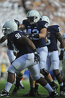 15 September 2012:  Penn State LB Michael Mauti (42) celebrates with DT DaQuan Jones (91). The Penn State Nittany Lions defeated the Navy Midshipmen 34-7 at Beaver Stadium in State College, PA..