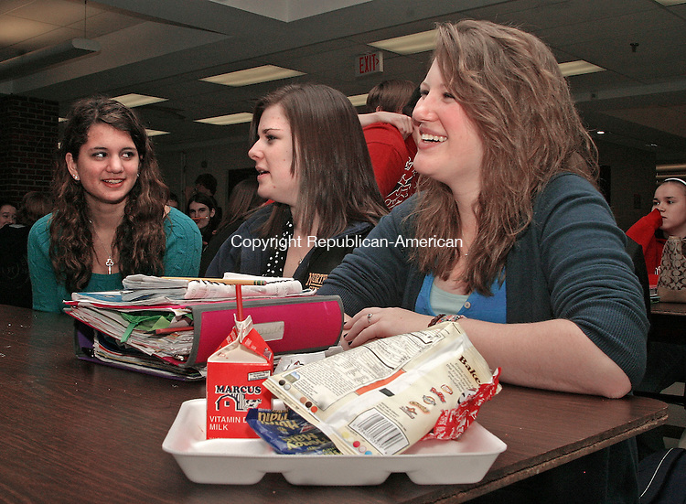 SOUTHBURY, CT.-28 JANUARY 2009-012810DA01- Students of Pomperaug High School in Southbury from left, Brianna Silver, April Albert and Emily Kaplita, socialize during their lunch period Thursday. School administrators are considering changes in school scheduling at Pomperaug High to add more classroom time. The changes could result in shorter lunch periods for students, which some are not happy about.   <br /> Republican-American  Darlene Douty