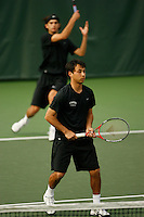 26 January 2006: Stanford's Jon Wong with partner Blake Muller in the backround during doubles action during the Cardinal's 6-1 win over Hawaii at the Taube Family Tennis Stadium in Stanford, CA.