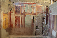 Fresco decoration of an architectural framework with statues, a tripod on a base, candelabra and a woman on a balcony with her maidservant, on the North wall of the Frigidarium or cold pool of the baths in the Casa del Criptoportico, or House of the Cryptoporticus, Pompeii, Italy. This room is decorated in the Second Style of Pompeiian wall painting, 1st century BC. The house is one of the largest in Pompeii and was owned by the Valerii Rufi family and built in the 3rd century BC. It takes its name from the underground corridor or cryptoporticus used as a wine cellar and lit by small windows. Pompeii is a Roman town which was destroyed and buried under 4-6 m of volcanic ash in the eruption of Mount Vesuvius in 79 AD. Buildings and artefacts were preserved in the ash and have been excavated and restored. Pompeii is listed as a UNESCO World Heritage Site. Picture by Manuel Cohen