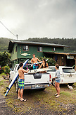 USA, Oahu, Hawaii, portrait of MMA Mixed Martial Arts Ultimate fighter Lowen Tynanes, Logan Garcia, Tyson Tynanes and Kyla Tipps getting ready to head to Pipeline at the house of pro surfer Sunny Garcia on the North Shore of Oahu