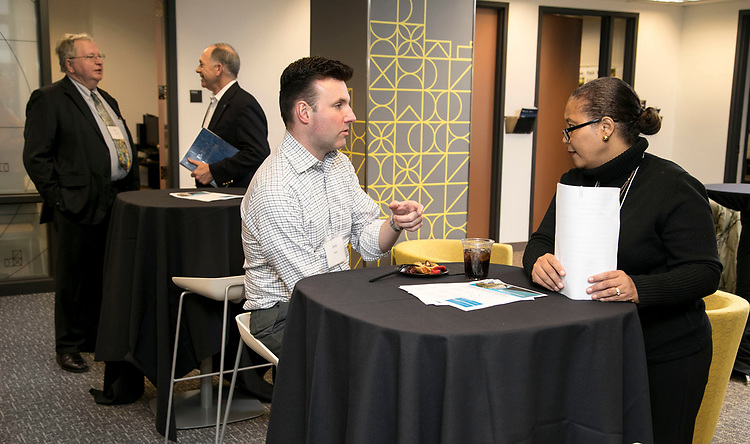 Andy Kaim, left, and Nadia André, chat as adjunct faculty members gather for a networking reception, Monday, March 5, 2018, in the Career Center on DePaul's Loop Campus. The gathering, hosted by the Workplace Environment Committee (WEC), offered participants the opportunity to meet fellow adjunct faculty members and learn about the many resources available through the Career Center. (DePaul University/Jamie Moncrief)