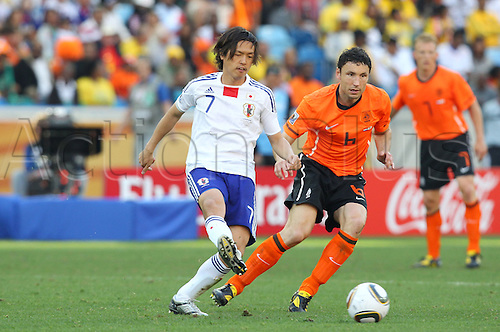 Yasuhito Endo (JPN), Mark van Bommel (NED), .JUNE 19, 2010 - Football : .2010 FIFA World Cup South Africa .Group Match -Group E- .between Netherlands 1-0 Japan .at Durban Stadium, Durban, South Africa. .